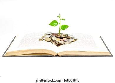 """tree growing from books with coins / A big open book with coins and tree. """"Reading makes you richer"""" concept."""