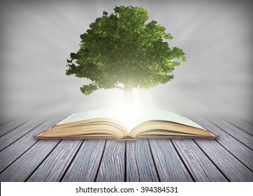 Tree growing from the old books, Education and knowledge concept