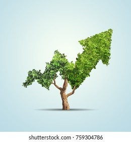 Tree grows up in arrow shape over blue background. Concept business image
