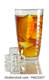 Tree ice cubes and cold tea in glass