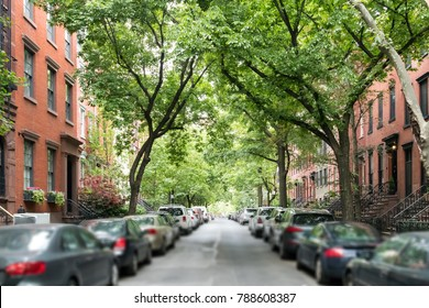 Tree lined street of historic brownstone buildings in a Greenwich Village neighborhood in Manhattan New York City NYC