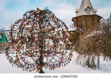 A tree with locks on the background of the church in the courtyard of the Izmailovo Kremlin in Moscow