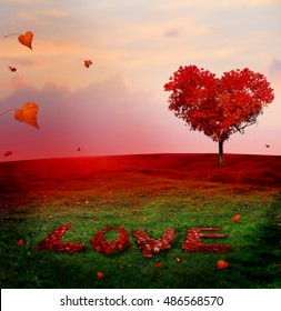 Tree of love in autumn. Red heart shaped tree at sunset.Autumn season concept  background.Beautiful landscape with red tree and falling leaves Love inscription from the autumn  leaves