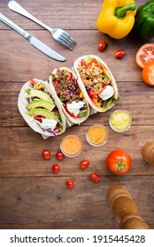 tree Mexican street tacos with with vegetables and pork and avocado and chicken. shot in panoramic composition