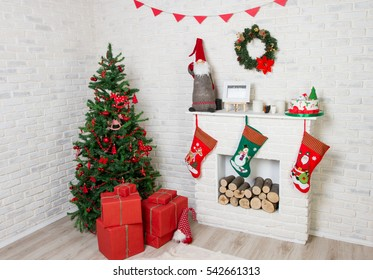 tree near the fireplace with gifts