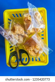 tree pork crackling pack in yellow basket with scissors