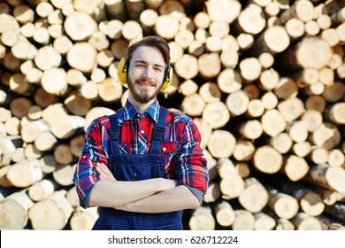 Tree service worker in protective headphones