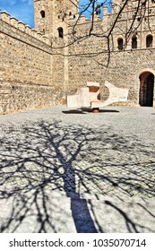 "Tree shadow in winter and sculpture,sequences from different viewing angles abstract sculpture called ""meeting place"" of Eduardo Chillida in square in Toledo, Spain."