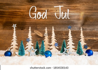 Tree, Snow, Blue Star, Ball, God Jul Means Merry Christmas, Wooden Background
