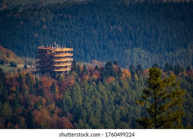 Tree top observation tower in resort town Krynica-Zdroj in autumn. View from Jaworzyna Krynicka Mountain.