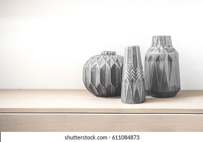 Tree vases made in porcelain in a living room on a bright shelf made on wood