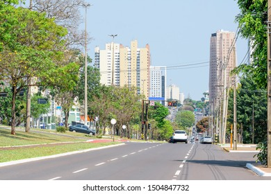 Tree-lined large avenue. City with many trees. Traffic at the Afonso Pena avenue - Campo Grande MS, Brazil. Main avenue of the city.