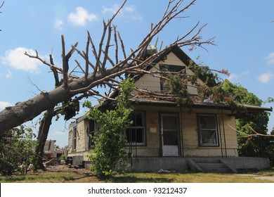 Trees in the direct impact of an EF-5 tornado are heavily damaged, causing further destruction to already fatally damaged man made structures.
