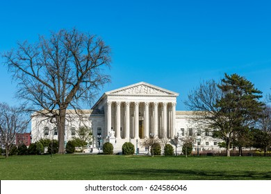 Trees frame the United States Supreme Court Building in Washington DC.