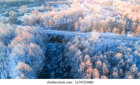 Trees with frost view from above. Aerial winter landscape of snowy frosty forest. Christmas background. Cold frosty winter morning.