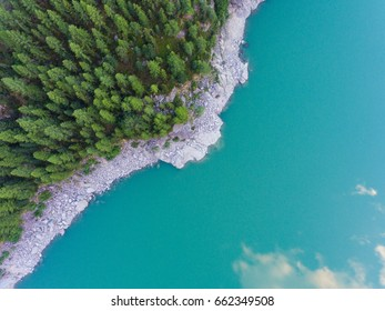 Trees and lake from above - Crystallin water and green forest - Aerial view with drone