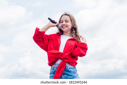 treets are singing. happy singer with microphone. girl singing. vocal school concept. karaoke club. music is my life. kid sing with mic. cheerful event manager. child have fun on party.