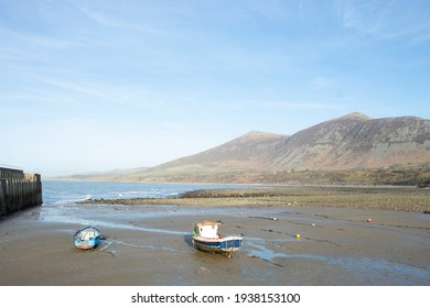 Trefor beach, Wales. Two small fishing boats at a secluded bay near Snowdonia on the Llyn Peninsula on a sunny, bright spring day. Peaceful placid countryside. Landscape aspect. Clear blue sky. - Shutterstock ID 1938153100