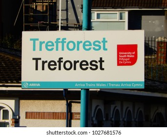 Treforest, Pontypridd, Wales - February 2018: Close up of a bilingual sign on a railway station with the name in English and in Welsh