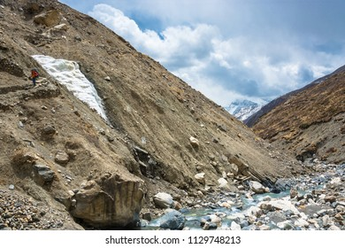 Trek around the Annapurna, Nepal – 06.04.2018: a Lonely hiker on the mountain path 6 April 2018 at the track around Annapurna, Nepal.