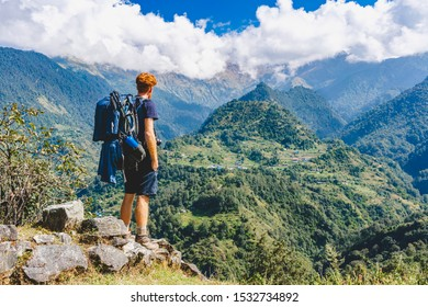 trekken and travel backpacker on stone panoramic mountains and forests blue sky with clouds asia travel