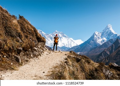 A trekker facing to Himalayan Mountains such as (from the left) Everest, Lhotse and Ama Dablam near Namche Bazaar, Sagarmatha national park, Everest Base Camp 3 Passes Trek, Nepal
