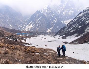 Trekker on the annapurna base camp trekking route (ABC) at Machhapuchhre. Beautiful landscape at Himalayas mountain. Trek in Nepal. Asia.