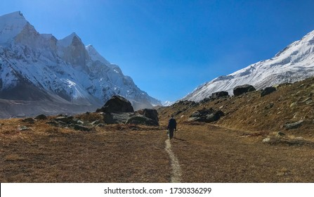 A trekker on a mountain trail of high altitude expedition in Indian Himalaya
