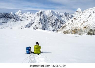 A trekker taking a rest while climbing to Island peak, Nepal