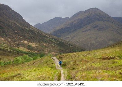 Trekkers hiking on  the Cape Wrath Trail in Scottish Highlands.