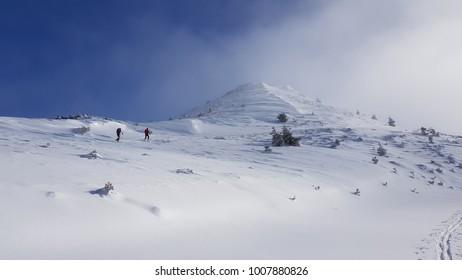Trekkers walking in the snowy mountains