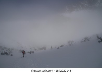 trekking above the clouds in the mountains - Shutterstock ID 1892222143