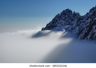 trekking above the clouds in the mountains - Shutterstock ID 1892222146