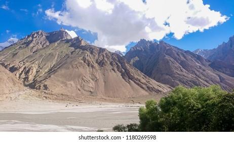 Trekking along the Braldu River in the Karakorum Mountains in Northern Pakistan, Landscape of K2 trekking trail in Karakoram range, Pakistan