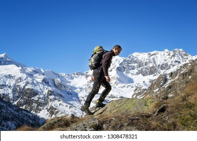 Trekking in the Alps in a beautiful sunny day. Grand Paradiso National Park. Italy