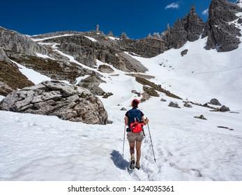 Trekking in the dolomites under the Tre Cime di Lavaredo Mountain