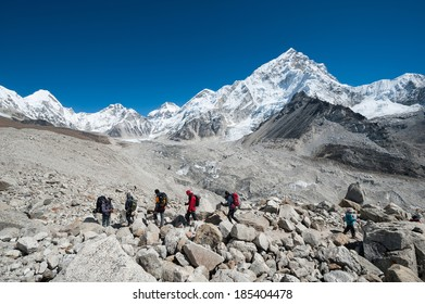 Trekking in Everest region, with Nuptse and the himalayas of Nepal in background.