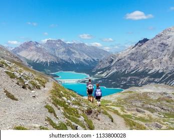 Trekking in mountain, hikers in Valtellina. Lakes of Cancano, Stelvio Nation Park