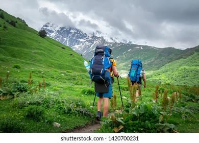 Trekking in mountains. Mountain trail with tourists. Svaneti mountains trekking. Active leisure in mountains