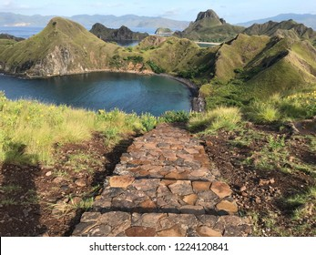 Trekking path to the top of Padar island in Komodo National Park Flores Indonesia surrounding by mountains and beautiful beaches