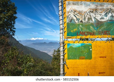 Trekking poster with travel route map at the viewpoint of Langtang range in the mountains near Dakshinkali, Nepal
