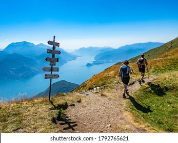 Trekking scene on Lake Como alps (the arrows indicates the names of the locations reached by the trails)