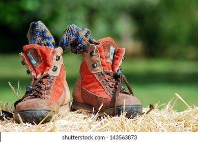 Trekking shoes with socks on straw