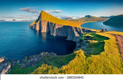 Trekking to Sorvagsvatn lake, Vagar, Faroe Islands, Denmark, Europe. Unbelievable summer seascape of Atlantic Ocean. Aerial landscape photography. Beauty of nature concept background. - Shutterstock ID 1880204845
