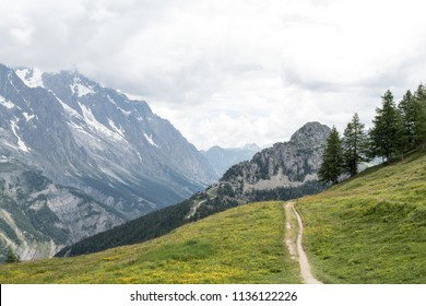 Trekking trail of the Tour du Mont Blanc trail (TMB) at Col Checrouit wit ha view on the South side of the Mont Blanc massif in summertime