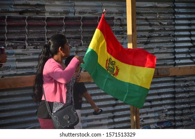 Trelew, Chubut, Argentina; november 25 2019: Bolivian women march protesting the coup d'état in Bolivia, in the framework of the marches for the International Day for the Elimination of Violence again