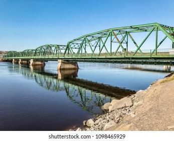 A trellis bridge for predestrians crossing the Riviere Saguenay in Chicoutimi, Quebec, Canada