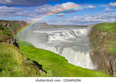 Tremendous Gulfoss waterfall in iceland with rainbow