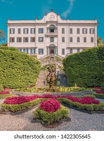 Tremezzina, Italy - August 06, 2016: Vertical shot of Villa Carlotta facade with the fountain and no people