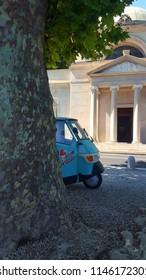 TREMEZZO, ITALY - JULY 18, 2018: Ice cream truck and chapel in Tremezzo, Italy.